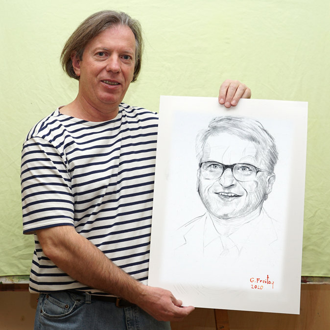 Gazmend Freitag with his portrait of Klaus Luger!